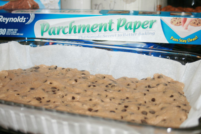Cookie Dough pressed onto parchment paper